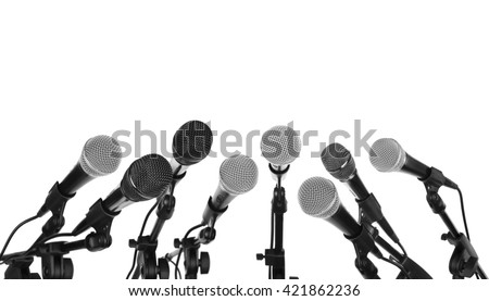 Several microphones prepared for press conference isolated on white - stock photo