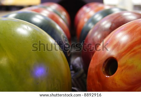 several multicolored balls for playing bowling - stock photo