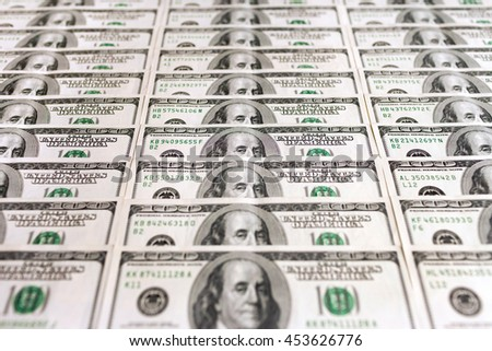 Several neat rows of United States of America one hundred dollar bills. Perspective view. - stock photo