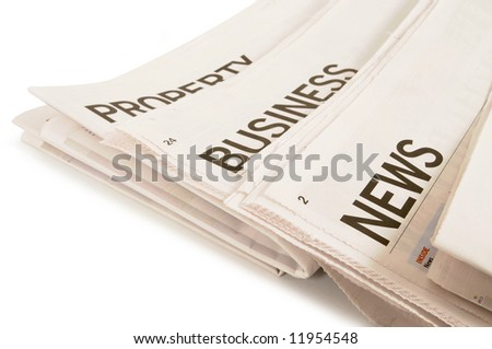 Several newspapers with business property news headlines isolated on white background