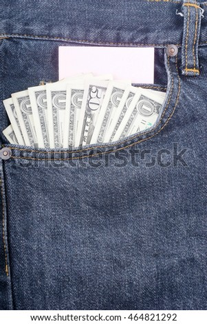 Several of banknotes dollars of USA sticking out of his jeans pocket