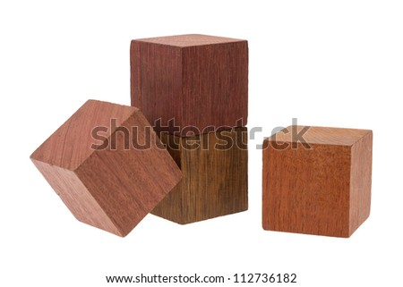 Several old cubes of wood, used by children for building (tropical wood)