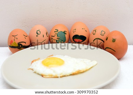 Several painted eggs near omelette sad - stock photo