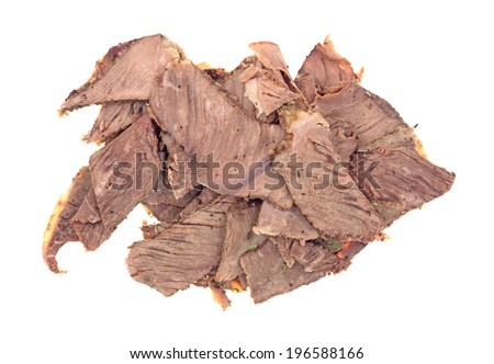 Several pieces of thin sliced chuck roast leftover meat on a white background. - stock photo