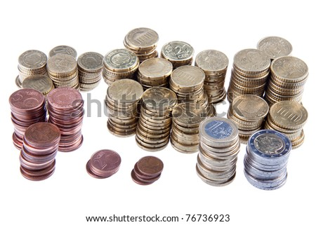 Several piles of european coins on a white background