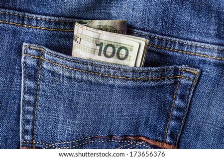Several Polish banknotes in jeans pocket - stock photo