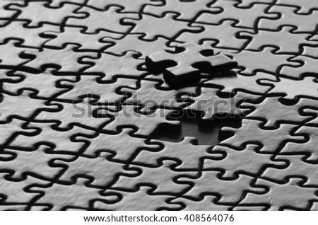 Several puzzle pieces put together symbolizing success and completion of a project - stock photo