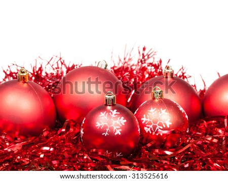 several red Christmas balls and tinsel isolated on white background