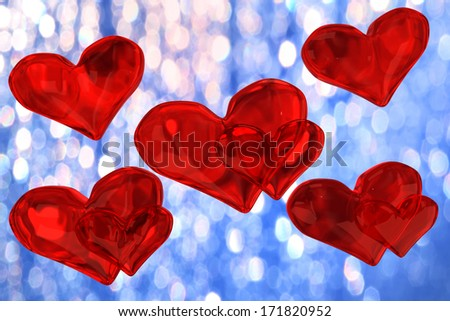 Several red hearts on the background blue bokeh - stock photo