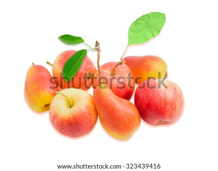 Several ripe red and yellow European pears and red apples with leaves on a light background. Isolation. - stock photo