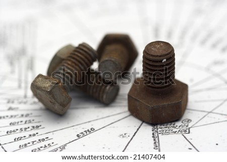 several rusty bolts close up with shallow Dof - stock photo
