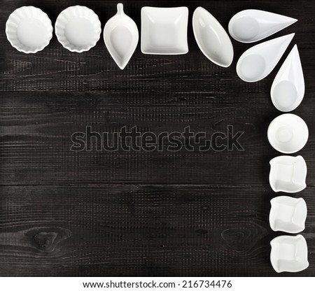 Several Sauce boat on black wooden rustic surface background  - stock photo