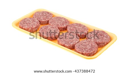 Several sausage patties on a yellow foam butcher tray isolated on a white background. - stock photo