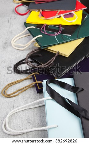 Several shopping bags on wooden background