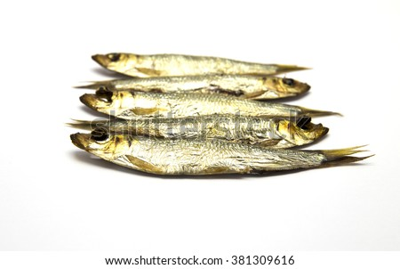 Several smoked European Sprats (Sprattus sprattus) on white isolated background - stock photo