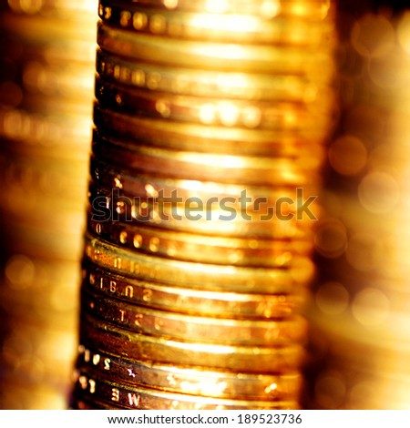 Several stacks of gold coins on blue background - stock photo