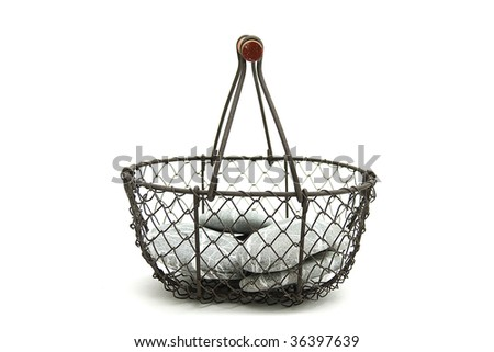 several stones in a little basket isolated - stock photo