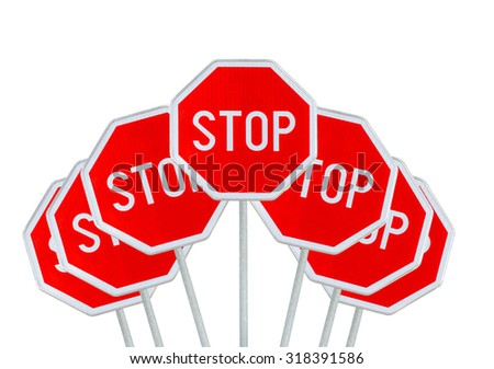 Several STOP sign isolated on white - stock photo