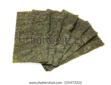 Several strips of dried seaweed sheets isolated on a white background.