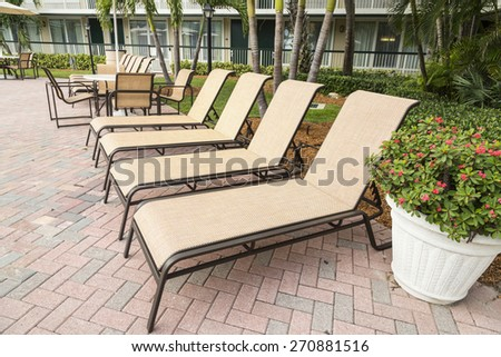 Several sun loungers by the pool - stock photo