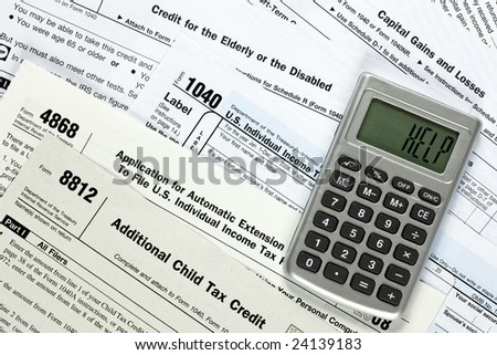 Several tax forms with a calculator that says help - stock photo