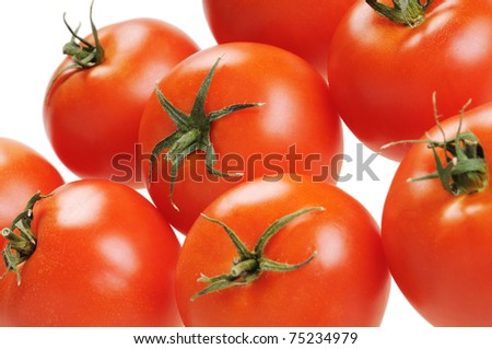 Several tomatoes, close-up. Isolated on white. - stock photo