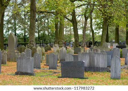 Several tombstones on a graveyard - stock photo