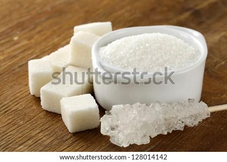 Several types of white sugar - refined sugar and granulated sugar - stock photo