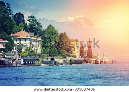 Several villas at the coast of Como lake in sunny day, Italy.