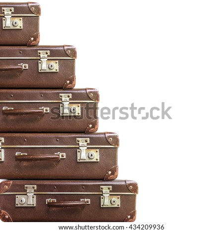Several vintage brown suitcase on white background
