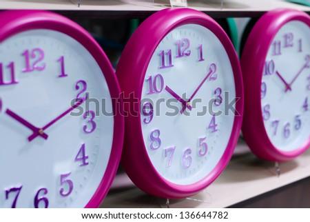 Several wall clocks on the shelf - stock photo