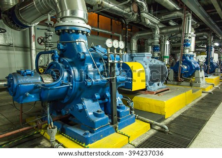 several water pumps with large electric motors - stock photo