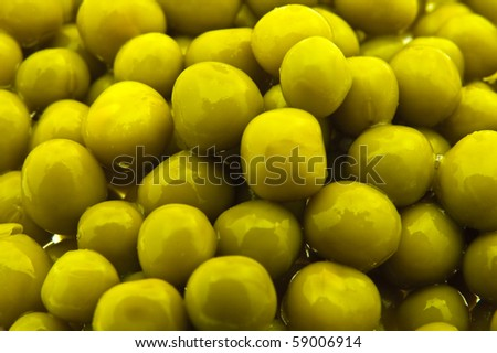 several wet peas from a can