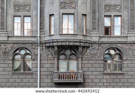 Several Windows In A Row And Balcony On Facade Of Urban Apartment Building  Front View,