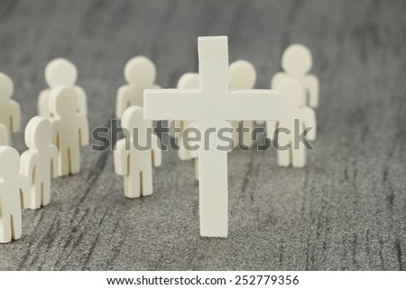 Several wooden figures with cross symbol A Christian community of faith