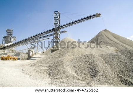 Several working belt conveyors and a piles of rubble in Gravel Quarry