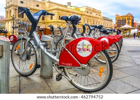 SEVILLA, SPAIN, JANUARY 7, 2016: view of a city bike stand in the spanish city sevilla. Biking is a popular way how to discover this andalusian city.