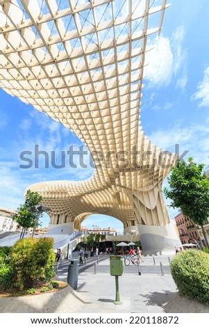 SEVILLA,SPAIN -JUNE 05 : Metropol Parasol in Plaza de la Encarnacion on June 05, 2014 in Sevilla, Spain. J. Mayer H. architects, it is made from bonded timber with a polyurethane coating. - stock photo