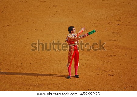 "SEVILLE - APRIL 30: Bullfighter David Fandila ""El Fandi"" presents the banderillas to the bullfight crowd at the Plaza de Toros de Sevilla April 30, 2009 in Seville, Spain. - stock photo"