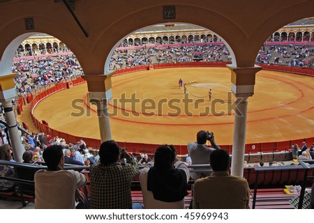 SEVILLE - APRIL 30:The ring is prepared as the spectators enter the stadium at the Plaza de Toros de Sevilla April 30, 2009 in Seville, Spain. - stock photo