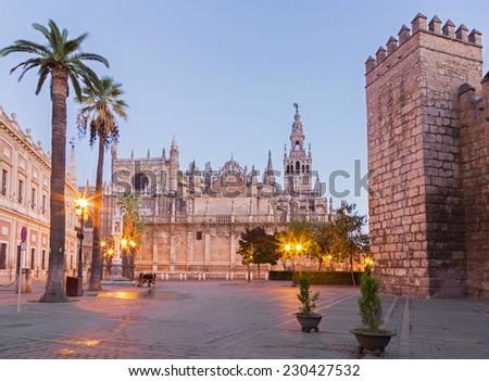 Seville - Cathedral de Santa Maria de la Sede with the Giralda bell tower in morning dusk. - stock photo