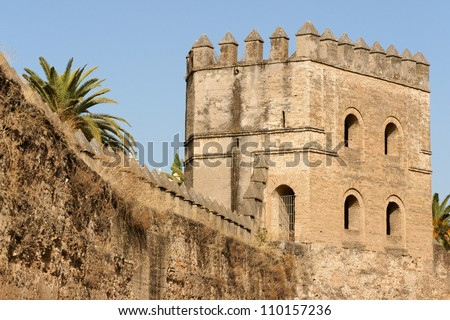 Seville, detail of the ancient city walls built during Almohad period to protect the town. - stock photo