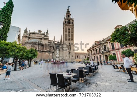 SEVILLE, ES - JULY 26, 2017: Terraces of the city of Seville in Andalusia, Spain.