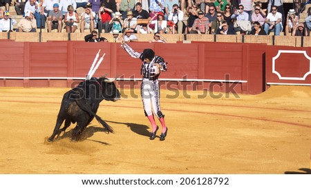 """Seville - May 16: Getting ready for excitement at the bullfight arena on May 16, 2010 in Seville (Spain). """"Corrida"""" (bullfighting) of bulls is Spanish tradition. - stock photo"""