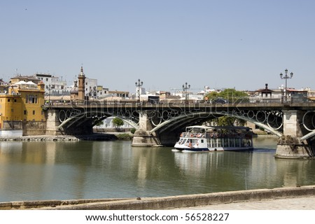 Seville - Rio Guadalquivir at Triana Bridge. View of Puente de Isabel II Triana, looking in a northwesterly direction from the east bank of the river - Spain