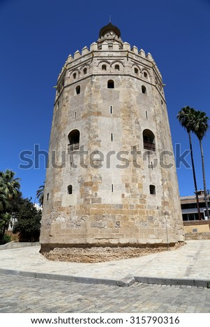 SEVILLE, SPAIN- AUGUST 27, 2014:Torre del Oro or Golden Tower (13th century), a medieval Arabic military dodecagonal watchtower in Seville, Andalusia, southern Spain