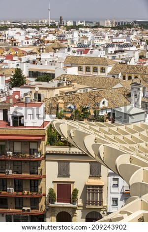 Seville, Spain - June 19: Metropol Parasol in Seville, Spain on June 19, 2014. This large wooden structure, designed by J. Mayer-Hermann, is made from bonded timber with a polyurethane coating. - stock photo