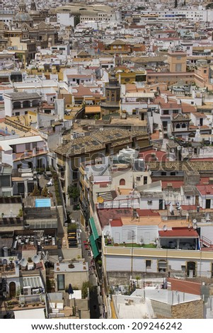 Seville, Spain - June 19: Panoramic view of Seville from Giralda tower in Seville, Spain on June 19, 2014. Giralda is a former minaret that was converted to a bell tower for the Cathedral of Seville.