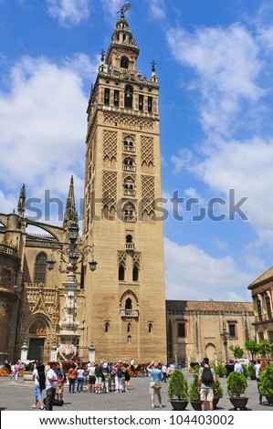 SEVILLE, SPAIN - MAY 18: Cathedral and La Giralda on May 18, 2012 in Seville, Spain. La Giralda, 104.5 meters high, a former minaret that was converted to a bell tower, is the icon of Seville