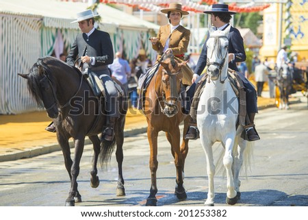 SEVILLE, SPAIN-MAY 8: People mounted on horse on fair of Seville on May 8, 2014 in Seville
